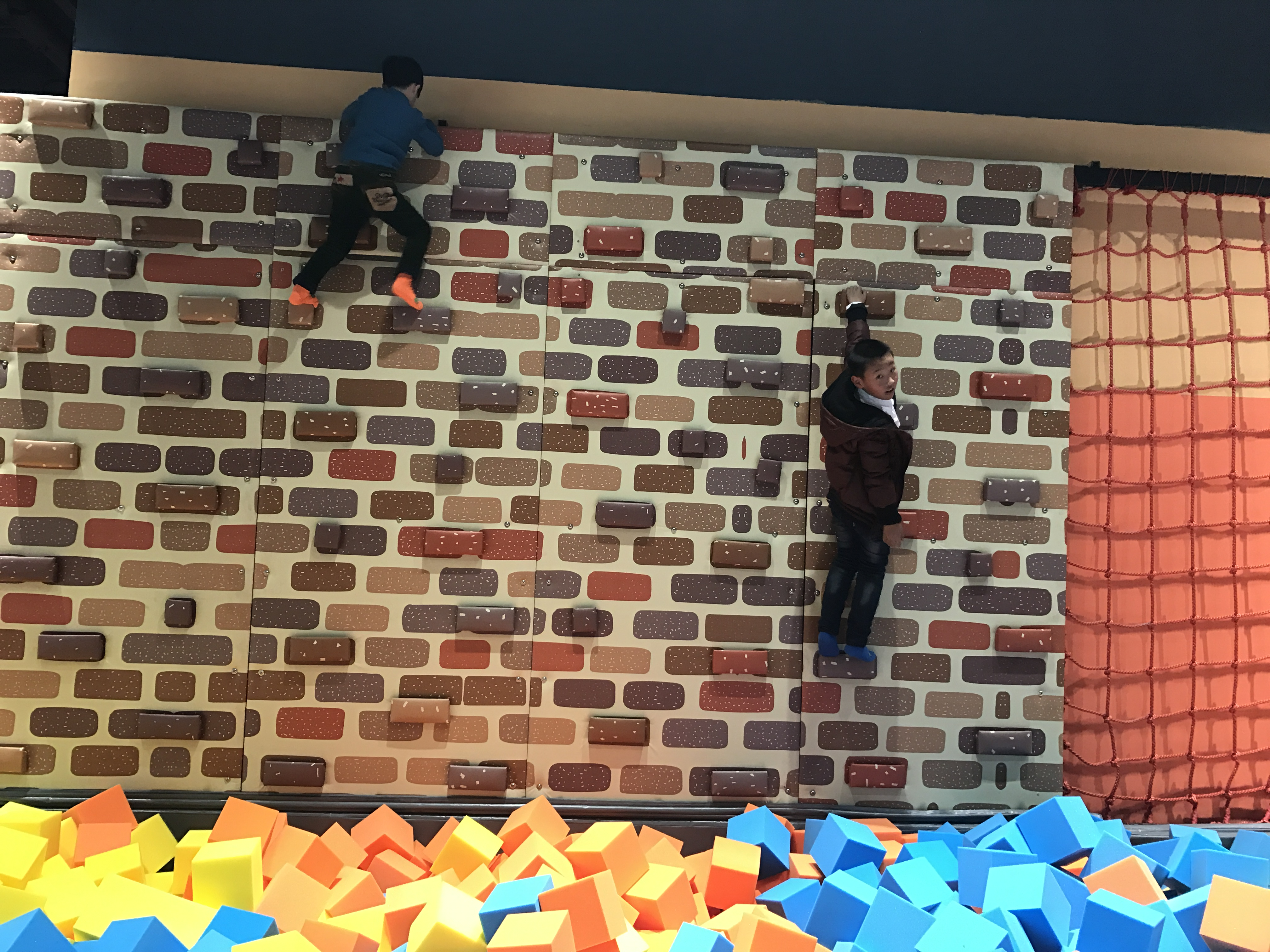 What are the benefits of climbing wall?